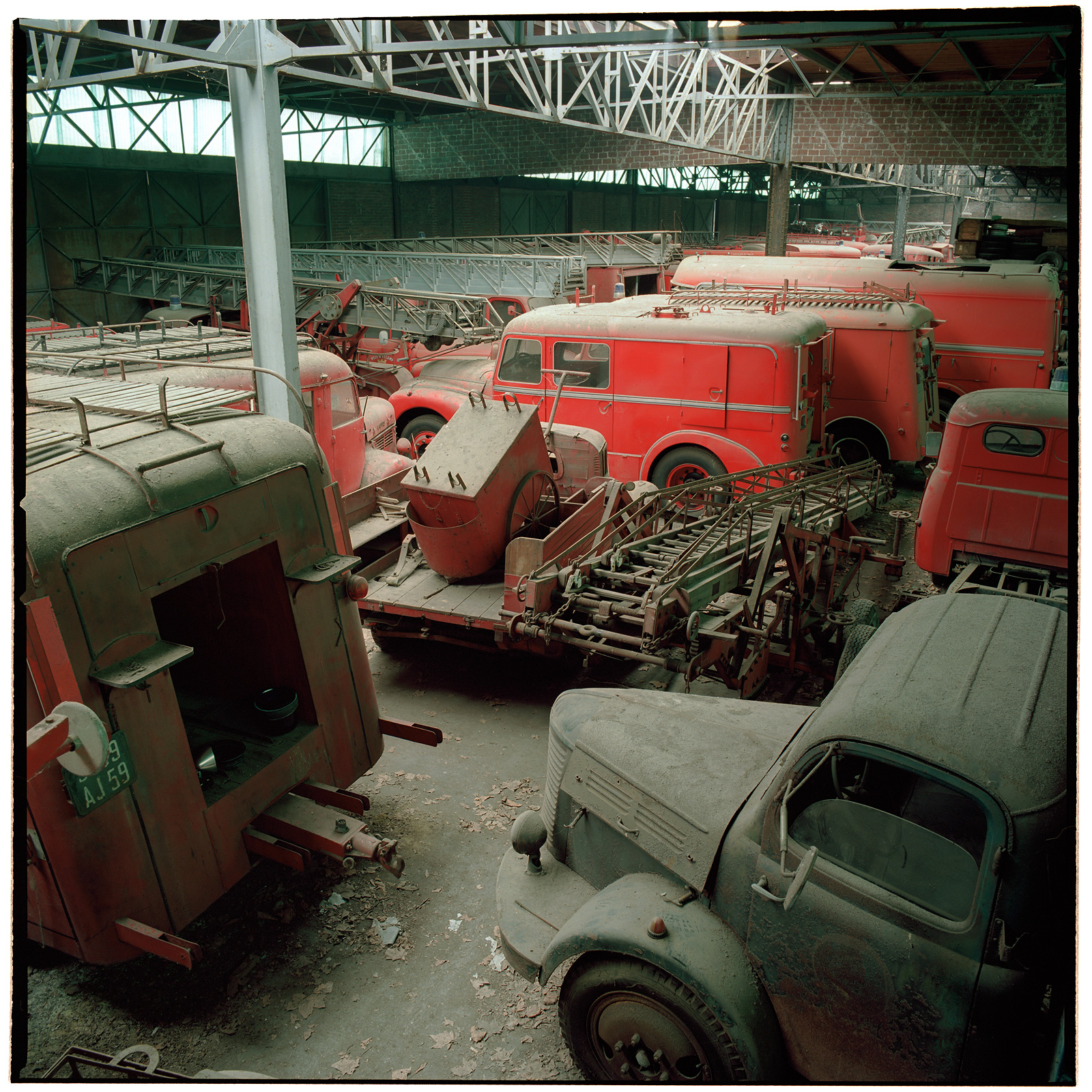 Not much parking space left in the old warehouse at Cimetière camions de pompiers, France.
